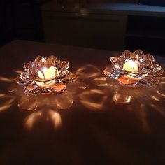 Simple elegance. Lotus Votive Holder Pair!  A favorite piece adds a stunning glow to any arrangement.  www.partylite.biz/camsflameslit
