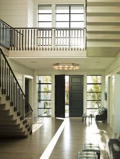 Ocean Modernist  Foyer  Staircase  Coastal  Contemporary by Steven Gambrel