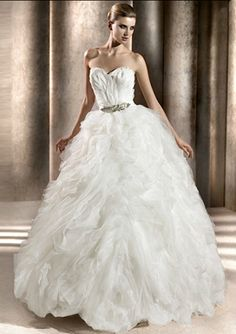 'Bengasi' by Pronovias.  Tulle and organza ball gown with feathers, a strapless sweetheart neckline and a full ruffled skirt.