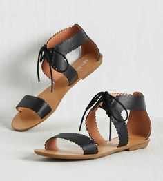 These leather-lined sandals with delicate, scalloped edges perfect for a stroll around town.