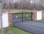 Estate - Arched Entry & Driveway Gates Brick columns with wood/PVC panels