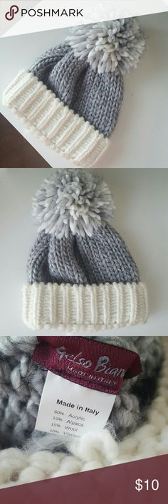 Wool pom pom hat Super cute! Very warm. Made in Italy. Worn few times, but in very good condition. Just as shown on the picture. Accessories Hats