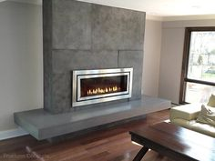 Concrete fireplace surround with a Regency Fireplace and floating hearth. Concrete Fireplace Surrounds -Trueform Concrete Custom Work