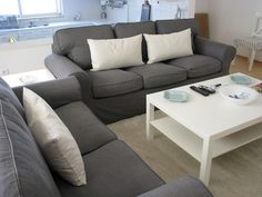 Ikea Ektorp sofas... Had one when I moved into my 1st apt. They get kind of comfy after a couple years =\