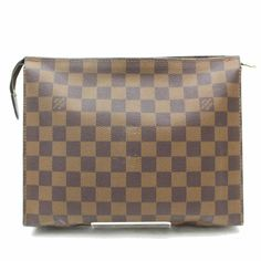 Get the trendiest Clutch of the season! The Louis Vuitton Toiletry Pouch Poche (Rare) Special Ed Damier Ebene Toilette 26 868988 Brown Coated Canvas Clutch is a top 10 member favorite on Tradesy. Louis Vuitton Clutch, Louis Vuitton Damier, Brown Fashion, Vintage Louis Vuitton, Authentic Louis Vuitton, Travel Bags, Flaws, Things To Sell, Leather