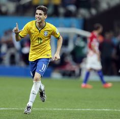 Oscar of Brazil celebrating his goal against Croatia in the 2014 World Cup