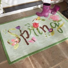 When winter has worn out its welcome, think ahead with our Spring Bloom Mat. Vibrant blossoms, cheerful greenery, and a hummingbird in flight celebrate the color and renewal of the spring season. Like sunshine melting the snow, this mat will warm up your entryway no matter what timetable Mother Nature observes.                Durable indoor/outdoor mat that spells out spring with a floral motif                    Hand-hooked, looped construction with fade-resistant fibers            ...