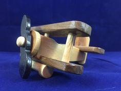 FREE SHIPPING IN U.S. Mini Wooden Toy Airplane Biplane # 1506  All Natural Hardwood Toy is designed & handmade for toddlers, nursery decor, or photo prop.  Sanded smooth & sealed with a natural gloss finish. Natural wood colors. No stain, paint, or artificial colors added. NO METAL NAILS or SCREWS * Propeller spins freely  DIMENSIONS: Length: 4.5 Width: 3.75 Height: 2.25  This wood toy is handmade and my vary slightly.  # 1506