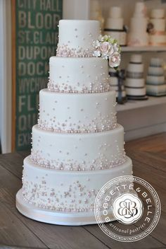 Beautiful wedding cake with pink beads