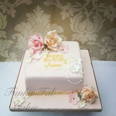 Vintage floral 80th birthday cake with sugar flowers