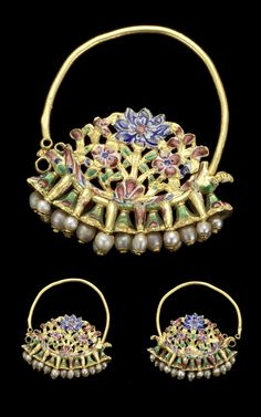 Persia | Pair of enamelled gold earrings; decorated with flower sprays and dragon-head terminals, band of bell-shaped drops inset with pearls below | 19th century | Est. 2'000 - 2'500£ ~ (Oct '11)