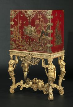 A William III Parcel-Gilt Scarlet-Japanned Brass-Mounted Cabinet On a Stand