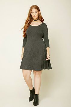 Forever 21+ - A knit skater dress featuring a scoop neckline and 3/4 sleeves.