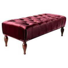 """Tufted velvet bench in burgundy with a wood frame and nailhead trim.  Product: BenchConstruction Material: Wood and velvetColor: BurgundyDimensions: 18"""" H x 47"""" W x 20.5"""" D Cleaning and Care: Dry clean or spot clean only"""