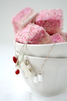 crushed candy canes over marshmallows     http://cannelle-vanille.blogspot.com/2008/12/bonbon-oiseau-and-my-candy-cane.html