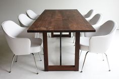 """This wood table is made in the heart of Ohio with walnut from Ohio. We use them both as a harvest dining table and desk. Each are hand-made with 65.5"""" long x 43.5"""" wide x 28.5"""" tall"""