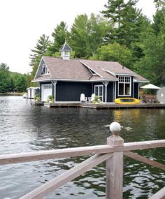 A lakeside cottage in Ontario, Canada, on Lake Rosseau, showcasing a boat house, with a wonderful water view!