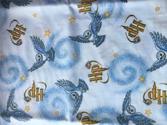 Harry Potters owl, Hedwig, is featured on this rare out-of-print white and baby blue Cotton from 2001.  18 x 22 100% Cotton  Machine Wash Cool, Tumble Dry, Low Cool Iron.  Soft Cotton designed by Springs industries, Inc.  Great for quilting, bedding, decor, crafts, clothing and cushions.  Price is for ONE Fat Quarter  US Shipping only
