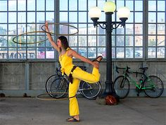 Artscape Hooping: Do You Know This Hooper? She's spinning 3 hula hoops while wearing a bright yellow jumpsuit. We love it! Photo by Mark Jonas.