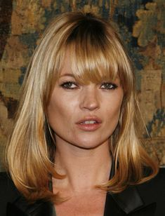 Kate Moss Medium Straight Cut with Bangs  Kate Moss showed off her super sleek mid-length bob and blunt bangs  br