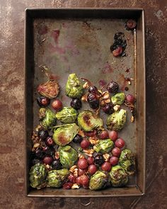 Roasted Brussels Sprouts & Grapes with Walnuts... this looks too good to be true!!! I'd crumble on some feta cheese to serve.   24 ounces brussels sprouts (about 8 cups), halved or quartered if large  24 ounces grapes  2 tablespoons extra-virgin olive oil  4 tablespoons fresh thyme  Coarse salt and freshly ground pepper  2 teaspoons balsamic vinegar  1/2 cup walnuts, toasted and coarsely chopped