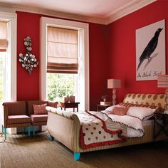the red walls and the bed legs painted in bright turquoise and the mirror....awesomeness