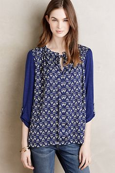 I bought this is the purple floral print. Evella Blouse #anthropologie