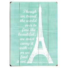 Plank-style wood wall decor with an Eiffel Tower and typographic motif.  Product: Wall decorConstruction Material:
