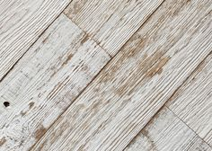 white painted wall cladding in long lengths planks. These planks have been expertly milled specifically for wall cladding, featuring a shiplap edge for ease of fitting and edge covering.