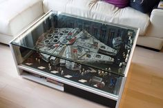 Fantastic idea to display a beloved creation in a safe, stylish way! Lego Falcon encased in a coffee table