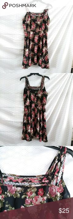 Black and red floral dress Beautiful black and red floral dress with thick straps that have braid and netting detail. Size small - will fit up to a size 4 best. Invisible zipper in the back. NWT! Dresses