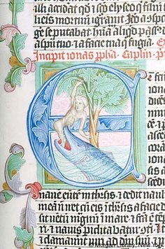 Bible, MS M.833 fol. 253r - Images from Medieval and Renaissance Manuscripts - The Morgan Library & MuseumJonah: cast up -- Jonah, emerging from mouth of whale, grasps tree with both hands. Filigree decoration in background of scene and foliate decoration in initial and on marginal extenders. Beginning of Jonah.