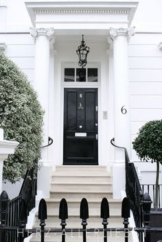 I am obsessed with black front doors. I wish the style of our house would look good with it.