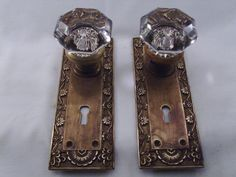 Antique 8 point Glass door knob sets c 1900, gently cleaned maintaining original patina, plates measure 7 1/2  x 2 1/4  Will cover round hole in modern