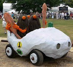 """From all-time classic 1968 Hanna-Barbera cartoon series """"Wacky Races"""" came the Slag Brothers (Rock Slag and Gravel Slag) who drove car number 1: The Bouldermobile. The series features 11 different cars and 24 characters racing against each other in various road rallies throughout North America, with each driver hoping to win the title of the """"World's Wackiest Racer.""""    Live Wacky Racers characters and their cars launch the Festival of Speed at Goodwood (UK)"""