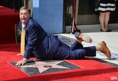 Actor John Goodman goofs around on his star during an unveiling ceremony honoring him with the 2,064th star on the Hollywood Walk of Fame in Los Angeles on March 10, 2017. Photo by Jim Ruymen/UPI