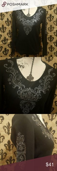 NEW LISTINGjeweled Reba top This is a jeweled Reba top black in color with no fading , no Jewels missing. No sign of wear.  Design of jewels are on both sleeves in the exact same spot. Reba Tops Blouses