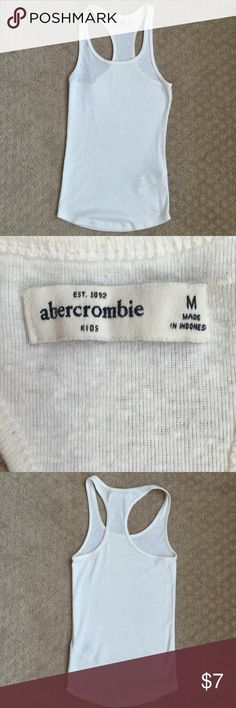 Abercrombie kids tank top white medium allover ribbed texture brings extra comfort to a classic racerback silhouette, featuring logo on bottom left, imported.57% Cotton, 38% Polyester, 5% Elastane  Do not dry clean Low iron if needed Machine wash cold, with like colors Only non-chlorine bleach Tumble dry low Abercrombie kids Shirts & Tops Tank Tops