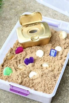 DIY Treasure Chest for Toddlers - I Can Teach My Child! - - This DIY Treasure Chest for Toddlers is made using recycled household materials! And the pieces are large enough they don't pose a choking hazard! Sensory Activities Toddlers, Sensory Bins, Infant Activities, Sensory Play, Preschool Activities, Indoor Activities, Sensory Table, Sensory Rooms, Toddler Activities For Daycare