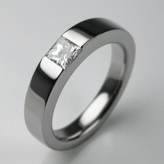A fabulous princess cut stone, set in a contemporary Times Square band handmade in solid precious metal. A very New York kind of ring. Chrysler, just look at it will you! Mine's a flat white double macchiato with a cucumber on the side, thanks... Great as an engagement or dress ring. Handmade in our London jewellery workshops in a variety of solid precious metal options including platinum, rose gold, white gold, diamond and ruby. Simply use the drop down menus to browse your options.