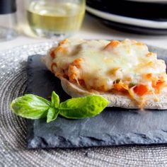 Quick and Easy Italian Bruchetta, topped with fresh tomatoes, basil and Mozzarella.