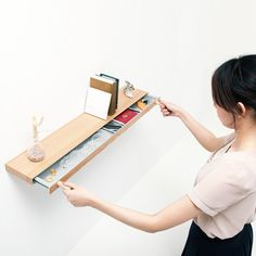 Clopen by Torafu Architects  The latest project by Japanese studio Torafu Architects may look like a standard floating shelf, but it actually contains a slim secret drawer that can be opened with magnets.  It's in production with Japanese firm Tanseisha.