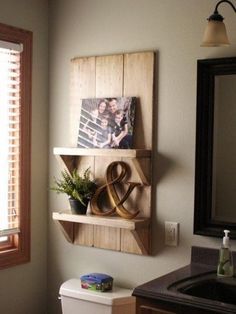 Shelf over toilet. Really like the concept of the shelf. Would be nice smaller/bigger/in a different room.