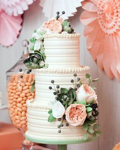 "Super versatile, buttercream can be shaped, spread smoothly, or piped as a designer sees fit, explains Amy Noelle, owner of NYC's Sugar Flower Cake Shop. ""Here, we combed the icing into a wavy pattern and capped off each tier with piped rope borders."" The sugar-flower arrangements feature handmade peonies, succulents, berries, and the intricate Juliet"