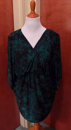 Green and black patterned top with kimono sleeves is an awesome choice for the office paired with paints or a pencil skirt!