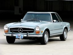 """1970 Mercedes Benz 280SL Convertible Roadster with 4-Speed, Air Conditioning & just over 31,000 Actual Miles. This is a very clean Mercedes-Benz has the """"Pagoda"""" style hardtop with a blue soft top and interior. The car comes with the original jack, tools and spare. The car his part of a large auto collection in the Newport beach area of Southern California."""