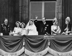 Princess Elizabeth and Prince Philip (centre) wave from the balcony of Buckingham Palace following their wedding ceremony, with (L-R) King George VI, Princess Margaret, Lady Mary Cambridge, Queen Elizabeth and Queen Mary of Teck, London, November 20th 1947.
