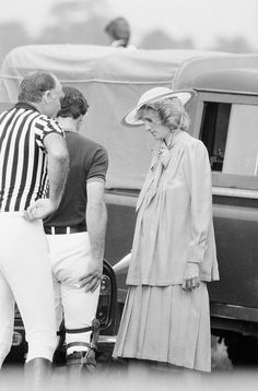 . Britain�s Princess of Wales, who is expecting her second child in September, looks on, as her husband Prince Charles prepares his equipment, prior to playing in a polo match at Windsor, England on June 20, 1984. (AP Photo/John Redman)