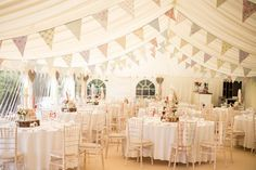 Country style decorated marquee, from a relaxed garden party wedding in Devon.