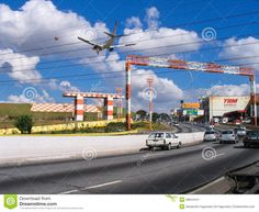 The airport of Congonhas, an aircraft from TAM landing over the street, Sao Paulo, Brazil. Description from dreamstime.com. I searched for this on bing.com/images